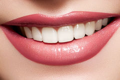 Macro happy female smile with health white teeth. Macro happy woman's smile with healthy white teeth, bright gloss lips make-up Royalty Free Stock Photography