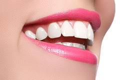 Macro happy woman's smile with healthy white teeth, bright pink . lips make-up. Stomatology and beauty care. Woman smiling. With great teeth on white background stock image