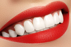 Macro happy woman's smile with healthy white teeth. Lips make-up. Stomatology and beauty care. Woman smiling with great teeth. Cheerful female smile with fresh Stock Photography