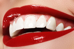 Macro happy woman's smile with healthy white teeth.Lips make-up. Stomatology and beauty care. Woman smiling with great teeth. Cheerful female smile with fresh Stock Images