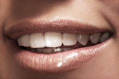 Macro happy woman's smile with healthy white teeth Stock Photography