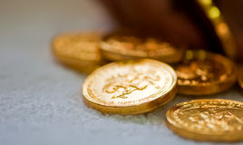 Macro of a heap of gold coins. With blurred background and copy space royalty free stock images