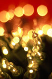 Macro of Holiday Lights. Bright bundle of yellow holiday lights with bokeh splashed everywhere. One light on the right is in focus. Unsharpened file Stock Photography