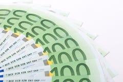 Macro hundred euro banknotes. Close-up of 100 Euro banknotes isolated on white background Royalty Free Stock Photo