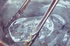 Macro ice in metal bucket in the restaurant Stock Photography