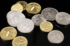 A close up image of Russian Federation coins on a black background. A macro image of an assortment of Russian Federation coins on a reflective black background stock photography