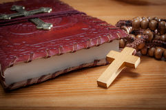 Macro image of a bible and a rosary Royalty Free Stock Images