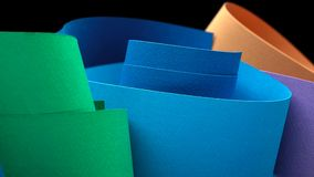 Macro image of colorful curved sheets of paper stock images