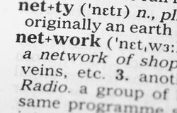 Macro image of dictionary definition of network Stock Photos