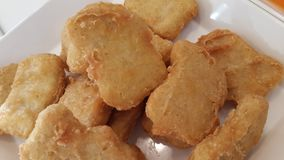 Fried Chicken Nuggets. Macro image of fried chicken nuggets Royalty Free Stock Photo