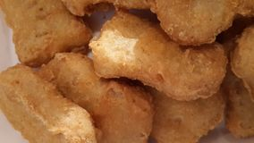 Fried Chicken Nuggets. Macro image of fried chicken nuggets Stock Images