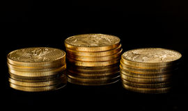 Macro image of gold eagle coin on stack Stock Image