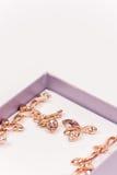 Macro image of golden earrings with diamond stones Stock Photography