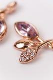 Macro image of golden earrings with diamond stones Stock Photos