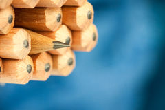 Macro image of graphite tip of a sharp ordinary wooden pencil as drawing and drafting tool, standing among other pencils Stock Images
