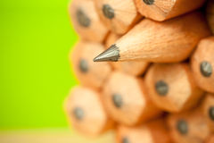 Macro image of graphite tip of a sharp ordinary wooden pencil as drawing and drafting tool, standing among other pencils Royalty Free Stock Image