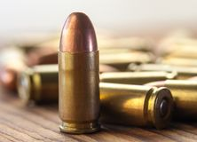 9mm bullets on wood. Macro image of a group of 9mm bullets Royalty Free Stock Photos