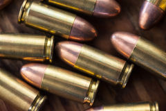 9mm bullets on wood Royalty Free Stock Photography
