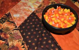 Closeup of Halloween candy corn in a bowl. Macro image of holiday candy corn. Autumn with Halloween brings trick or treat fun to the door royalty free stock images