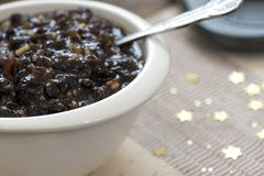 Mixed fruit and brandy mincemeat. Macro image of homemade traditional Christmas mincemeat made with mixed fruit and brandy in a white bowl, focus on the subject Stock Photos