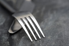 Macro image of knife and fork on rustic background Stock Photo