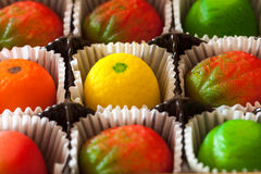 Macro image of marzipan fruit candies Royalty Free Stock Images