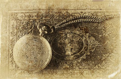 Free Macro Image Of Old Vintage Pocket Watch On Antique Book. Top View. Retro Filtered Image, Old Style Photo Royalty Free Stock Photos - 48766748