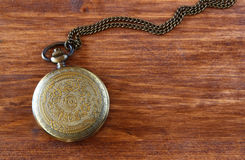 Macro image of old vintage pocket watch on wooden table. top view. Royalty Free Stock Image