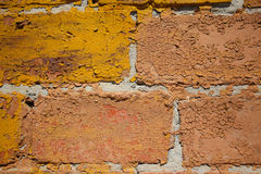 Macro image of painted and peeled off brick wall Stock Photos