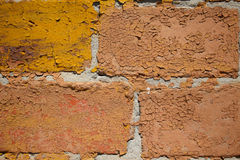 Macro image of painted and peeled off terracotta brick wall Royalty Free Stock Photography