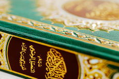 An macro image of the Quran. The Quran literally meaning 'the recitation' is the central religious text of Islam, which Muslims believe to be the verbatim word Royalty Free Stock Photo