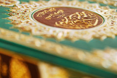 An macro image of the Quran. The Quran literally meaning 'the recitation' is the central religious text of Islam, which Muslims believe to be the verbatim word Royalty Free Stock Photos