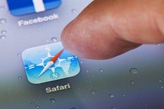 Macro image of running Safari web browser on an. Hong Kong, China - July 23, 2011: Macro image of clicking the Safari web browser icon on an iPad screen stock image