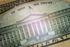 Macro. Image of the US Department of the Treasury Building and the inscription In God we trust. Part of the ten-dollar US bill on royalty free stock photos