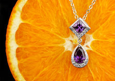 Macro of jewelry with gems on fruit background with copy space Royalty Free Stock Photos