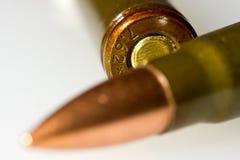 Macro of kalashnikov bullets lying across Stock Images