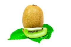 Macro kiwi fruit on leaves Royalty Free Stock Photos