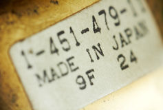 Macro of a label sticker. Royalty Free Stock Images