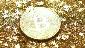 Macro Light Reflects Coin Created As Virtual Currency. Macro light reflects smoothly on metal coin created as currency cost which regulated by market demand and stock video footage