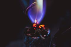 Macro of lighting up a cigarette with marijuana, Royalty Free Stock Images