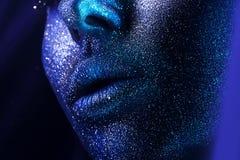 Macro lips with blue bodyart Royalty Free Stock Photography