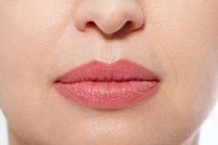 Macro lips makeup. Close up female mouth. Plump full lips. Close-up pores and face details. Collagen and face injections. Anti agi. Ng Plastic surgery. Selective stock photography