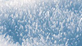 Macro look of snow crystals, snowflakes. Winter background, banner 16x9 format.  royalty free stock photos