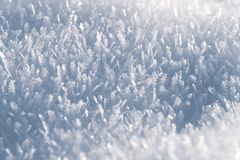 Macro look of snow crystals, snowflakes. Winter background stock image