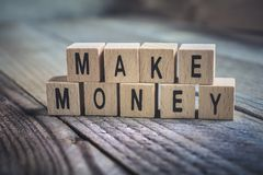 Macro Of A Make Money Reminder Formed By Wooden Blocks On A Wooden Floor royalty free stock photography