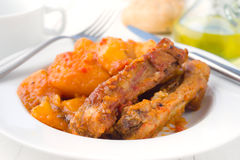 Macro make serving of pork stew in white dish on wooden Royalty Free Stock Photography