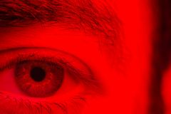 Macro on man eye expressing serious and expressionless expressio. N Royalty Free Stock Photo