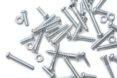 Macro Of A Medium Size Collection Of Iron Screws And Bolts In A Whitebox Royalty Free Stock Image