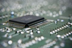 Macro of microchip on the circuit board Stock Image