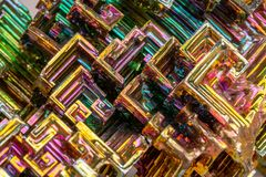 Macro of the mineral bismuth stone on a white background stock photos